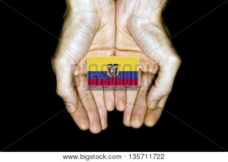 Flag Of Ecuador In Hands On Black Background