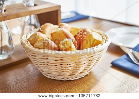 The bread basket on table in restaurant
