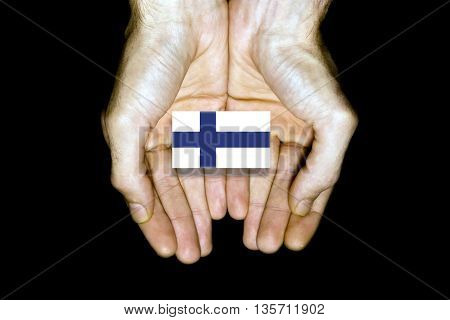 Flag Of Finland In Hands On Black Background