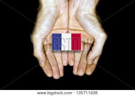 Flag Of France In Hands On Black Background