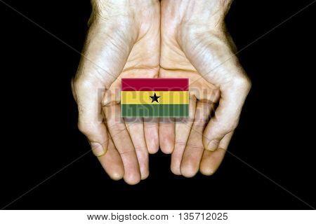 Flag Of Ghana In Hands On Black Background
