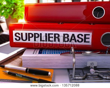 Red Office Folder with Inscription Supplier Base on Office Desktop with Office Supplies and Modern Laptop. Supplier Base Business Concept on Blurred Background. Supplier Base - Toned Image. 3D.
