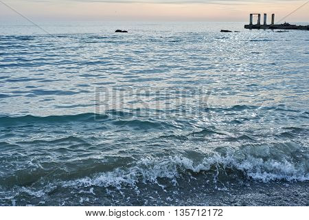 Blue sea water on the sunset background
