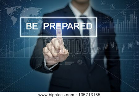 Businessman hand touching BE PREPARED button on virtual screen
