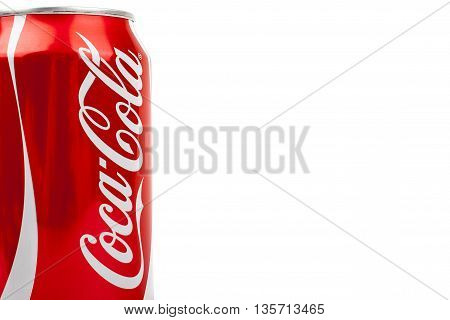 LONDON UK - MAY 6TH 2016: Abstract view of a can of Coca Cola drink isolated over a plain white background on 6th May 2016. The drink is produced and manufactured by The Coca-Cola Company.