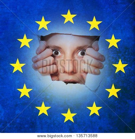 Surprised citizen looking through tor EU flag - uncertainty after Brexit