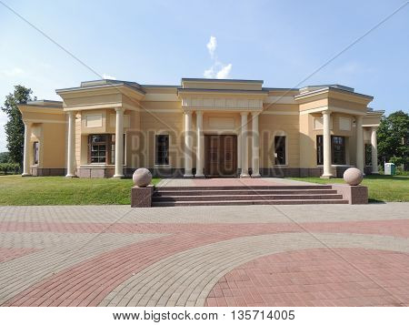 architecture yellow building with columns entrance stairs
