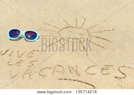 sun glasses in the sand at the beach
