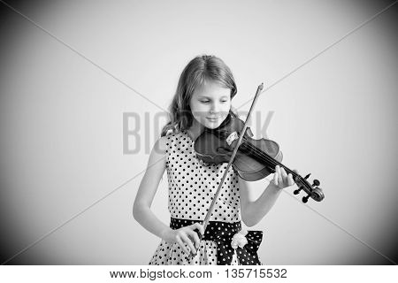 Portrait Of Girl With String And Playing Violin.