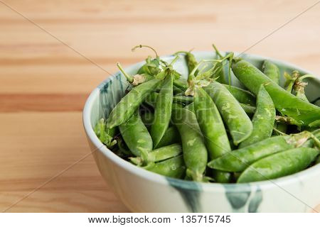 Green Peas Into A Bowl