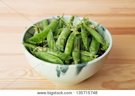Green Pods With Peas As Background