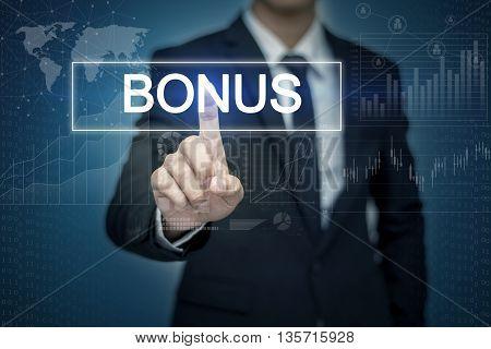 Businessman hand touching BONUS button on virtual screen