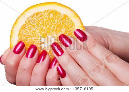 Hand With Manicured Nails Touch An Orange On White