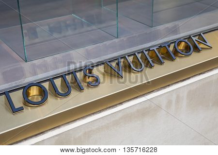 LONDON UK - APRIL 7TH 2016: A close-up of a Louis Vuitton symbol at their store on New Bond Street in London on 7th April 2016.