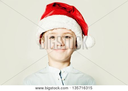 Christmas Kid in Santa red Hat smyling