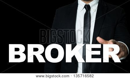 Business man pointing the text: Broker