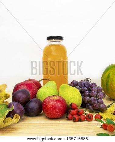Glasses of tasty fresh juice on wooden table.