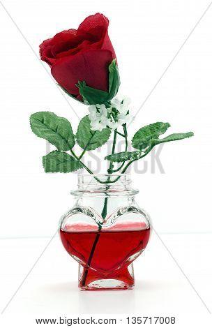 A Rose in a heart shaped bottle