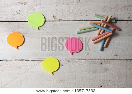 Sticky Notes With Colored Markers On Wooden Background Top-view