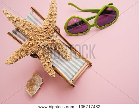 Starfish on a deckchair travel concept image