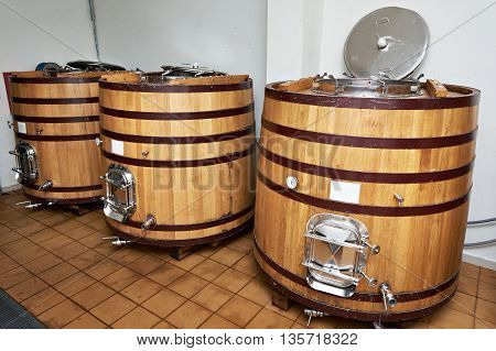 Wooden Tank Barrels For Aging Wine At Winery