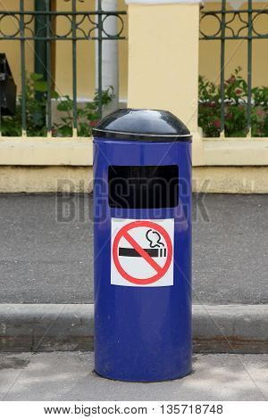 blue metal city trash can with ashtray and no smoking sticker