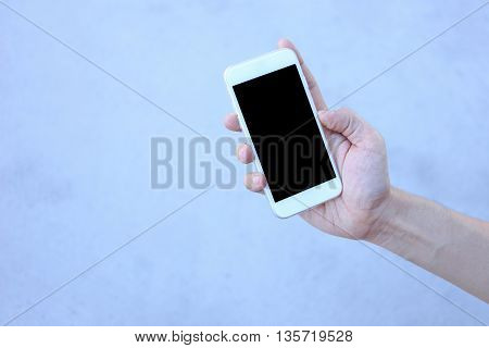 Smartphone in hand hand holding white smartphone
