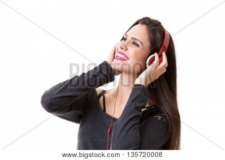 Young brunette girl listing to music