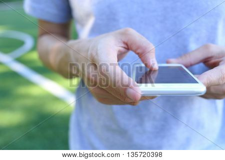 Hand holding with touch on white smartphone