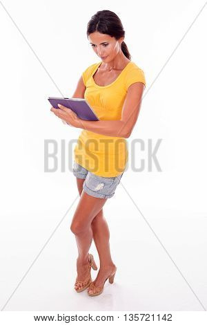 Smiling Young Brunette With A Tablet Pc