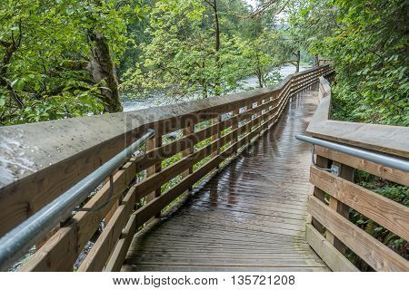 An elevated walkway follows the Snoqualmie River in Washington State.