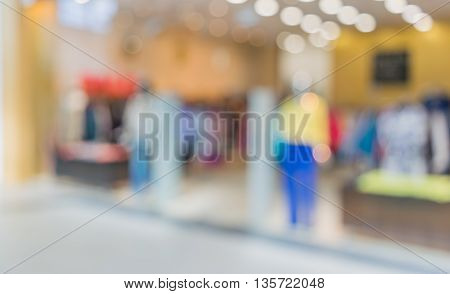 Shelves with goods in a supermarket. Blur and defocus image as a background and designs postcard, menus, catalogs.