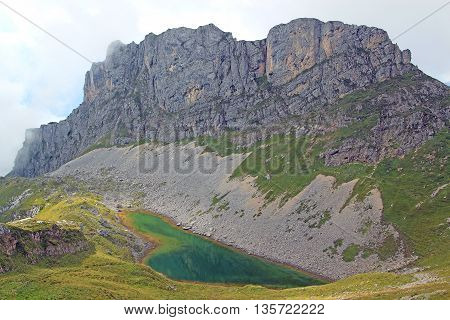 View On Mountain Chain And Mountain Lake In The Alps (rofan)