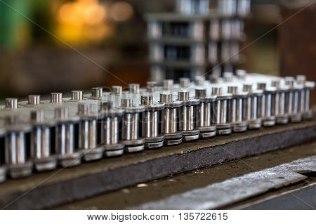 Engineering plant for the production of parts. Photo roller chains in the Assembly process.