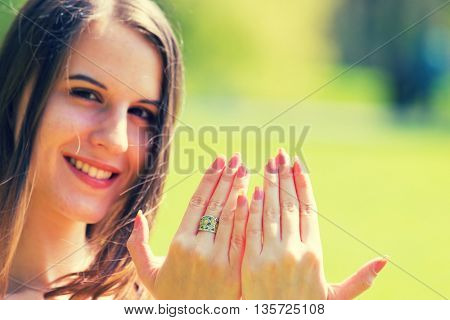 girl shows fingernails. Toned photo