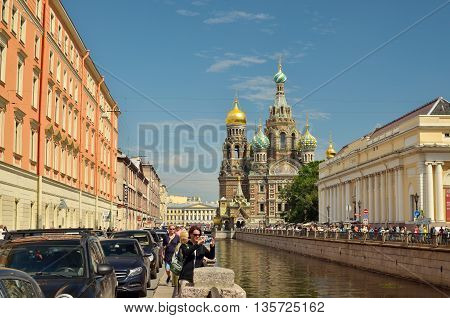 24.06.2016.Russia.Saint-Petersburg.At the centre of the city overlooking the famous Church of the Savior on Blood.He stands on the canal.