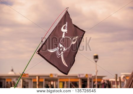 Pirate flags in the wind on a blue sky