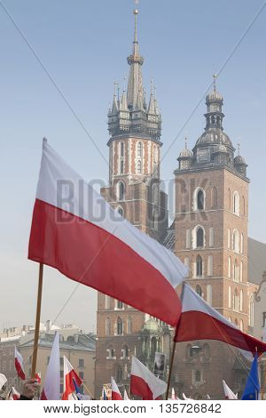 Poland Krakow Polish Flags foreground Towers of St Mary Church background demonstration clear sky