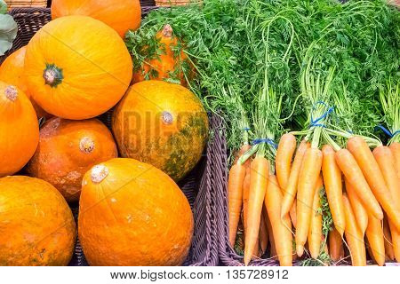 Pumpkins and carrots for sale at a market