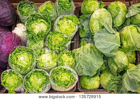 Salad and cabbage for sale at a market