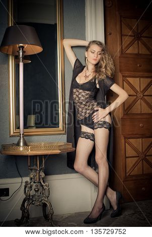Women's body black underwear in vintage interior