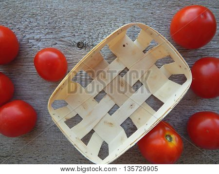 Close up portrait of spilled tomatoes from rattan basket