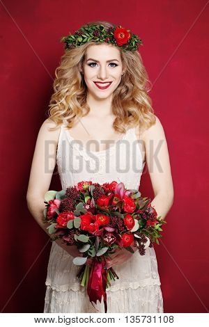 Fashion Woman with Curly Blond Hair. Bride with Flowers