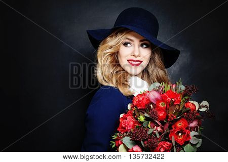 Happy Lady Fashion Model with Flowers on Background with Copy Space for Text
