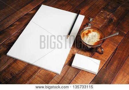 Blank paperwork template on vintage wooden table background. Responsive design mockup. Mock-up for your design.