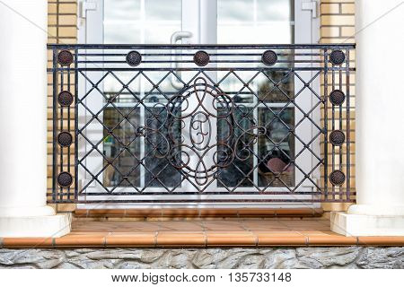 The section of decorative wrought metal fencing