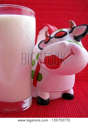 sweet cow and glass of milk