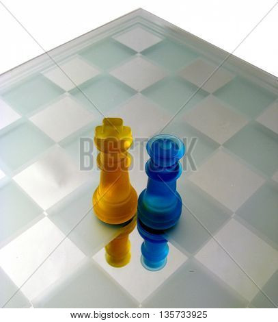 lonely king and queen on chess table