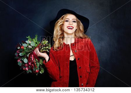 Laughing Woman with Flowers on dark background