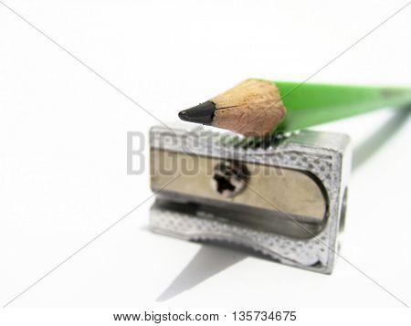 closeup of sharpener and green pencil
